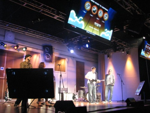 The Harmonix team behind closed doors at E3 explaining Rock Band: The Beatles' six-part harmonies.